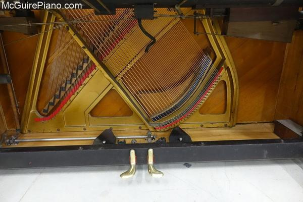 Adam Schaaf Piano bottom board is reinstalled